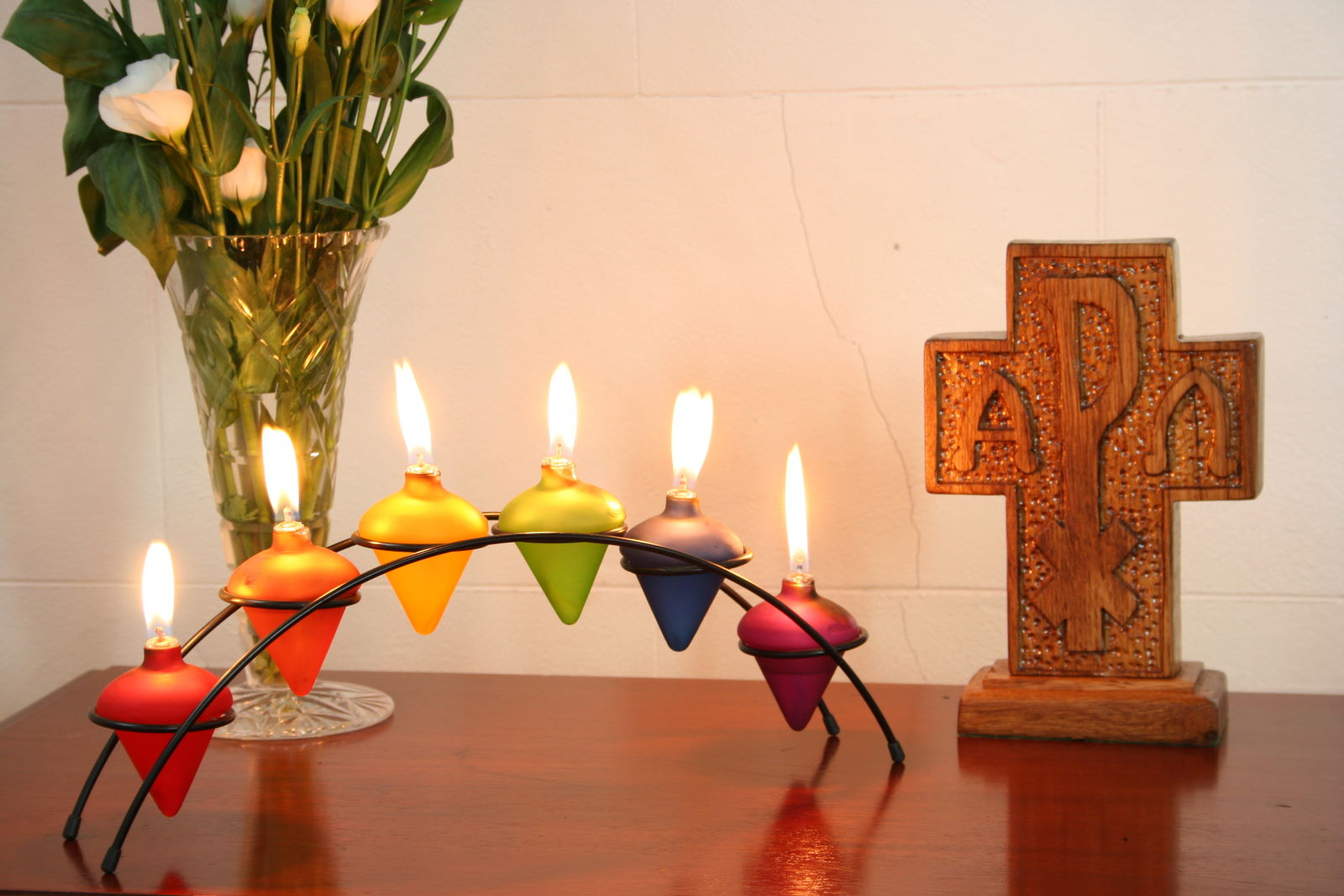Rainbow candles in the prayer chapel of Inclusive Community Church.
