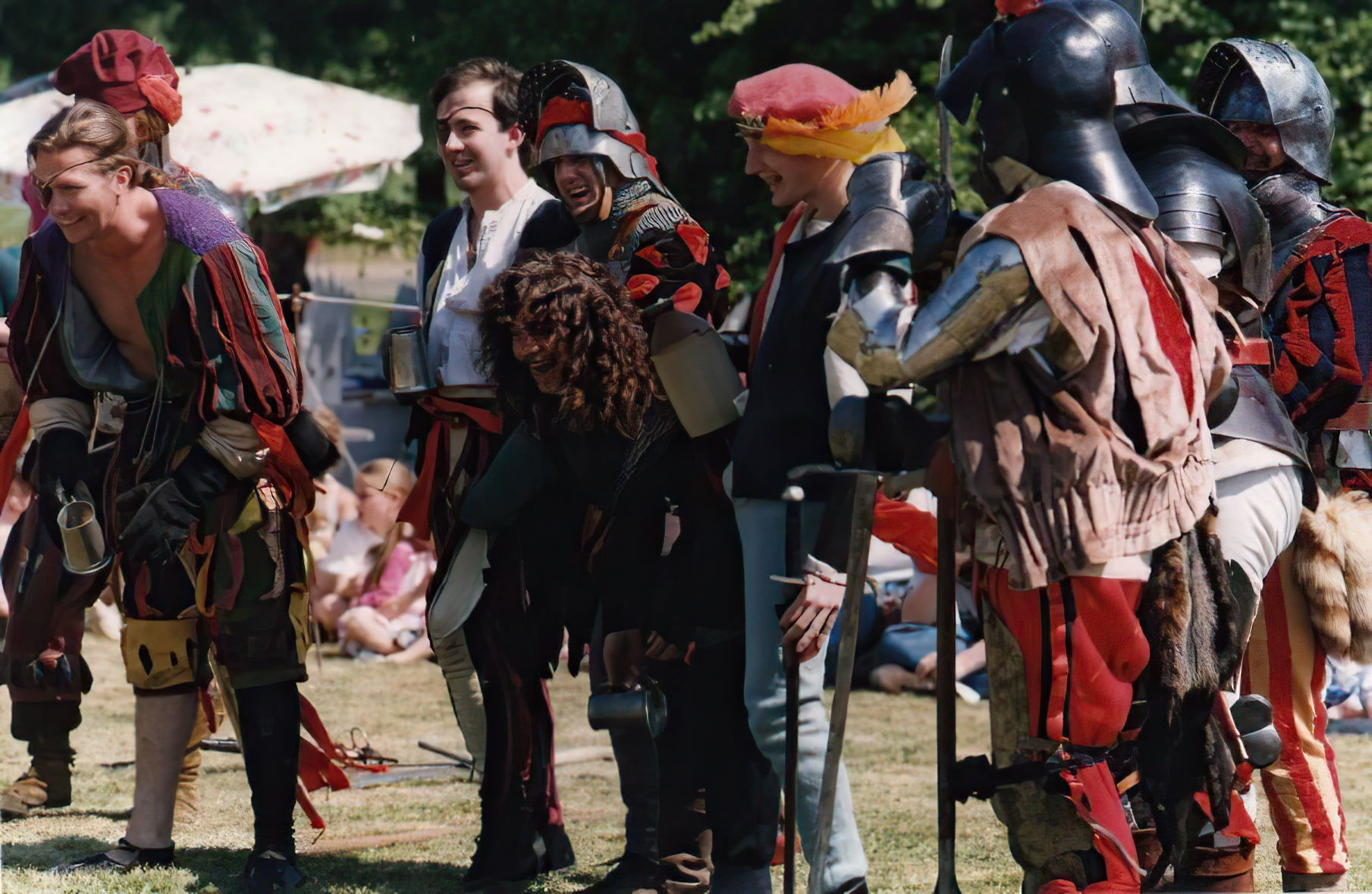 The Morrigan's Landsknect contingent at an event in Maidenhead in 1995. I'm the one in the centre wearing a salet and black and red doublet